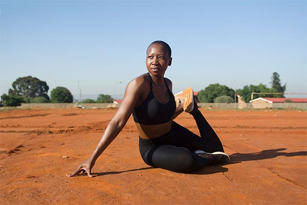 woman exercising while wearing a sports bra