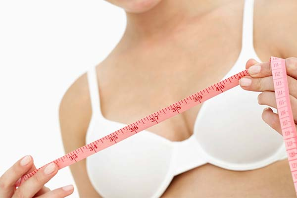 woman measuring band size